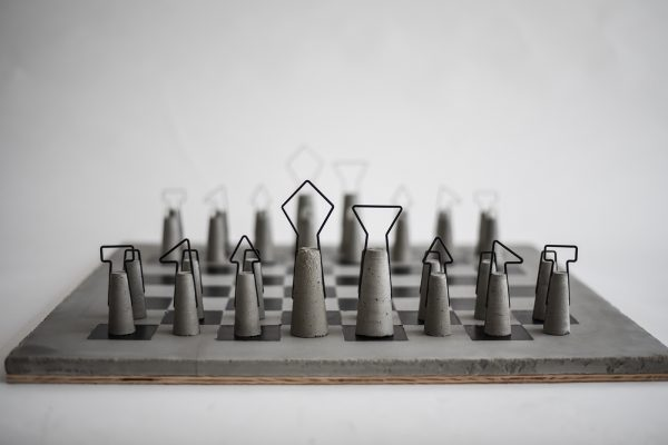 Iron-concrete chess set by Daniel Skoták